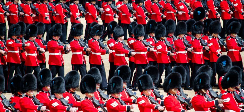 men in red uniform playing instrument